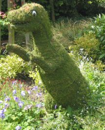 Topiary Tyrannosaurus With Moss Filling