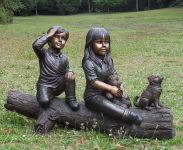 Boy, Girl And Dog On Tree Statue