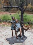 Boy And Girl On Swing Statue