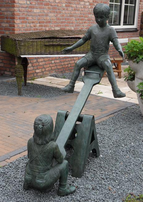 Girl And Boy On Seesaw Statue
