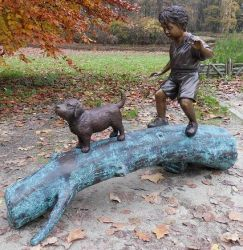 Boy With Dog On Tree Statue