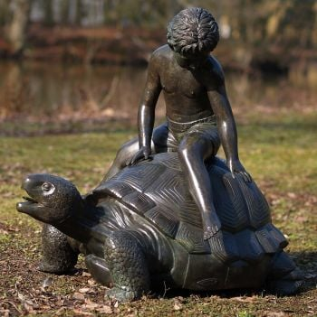 Boy Sitting On Turtle Statue