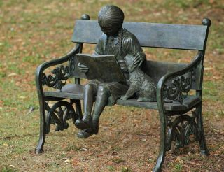 Girl And Dog On Bench Statue