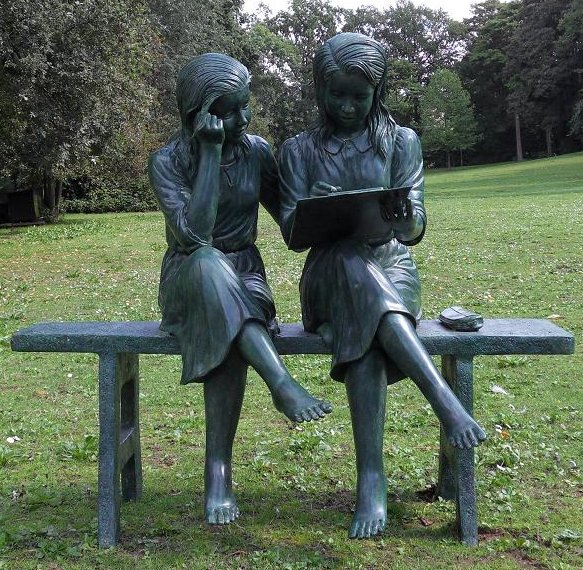 2 Girls On Bench Statue