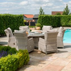 Maze Rattan Cotswolds Garden 6 Seater Round Table Dining Set with Reclining Chairs and a woven Lazy Susan in Grey/Taupe