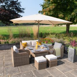 Luxury 6 Seater Garden Sofa Set with Square Rising Table and Parasol in Natural Rattan by Primrose Living