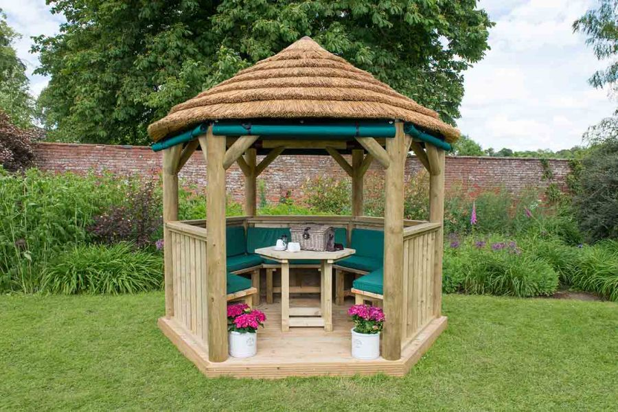 10ft (3m) Hexagonal Wooden Garden Gazebo with Thatched Roof - Furnished with Table, Benches and Cushions (Green)