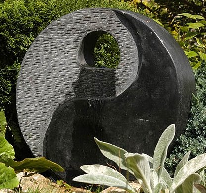 Circular granite water feature for Jardin yin yang