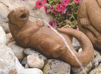 Lying Otter Cast Stone Spitting Water Feature H19cm x W18cm
