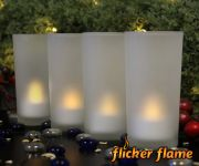 Flicker Flame� Set of 4 White Rechargeable Tealights with Glass Votive Holders