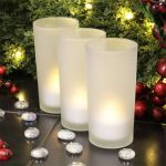 Flicker Flame� Set of 4 Rechargeable White Tealights with Glass Votive Holders